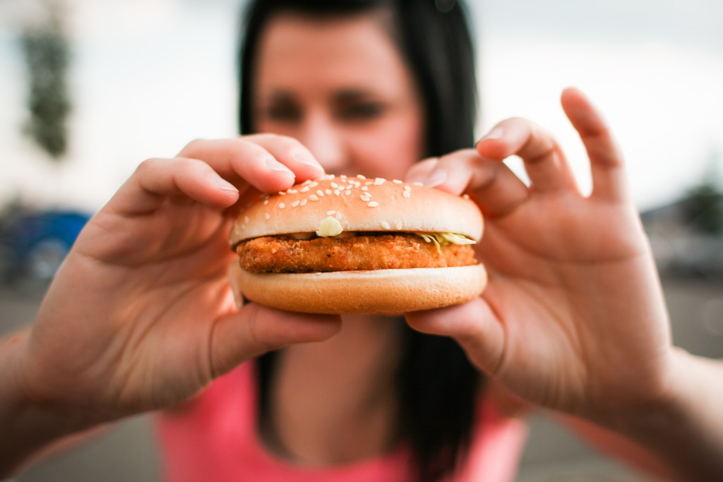 girl-holding-hamburger-in-her-hands-picjumbo-com